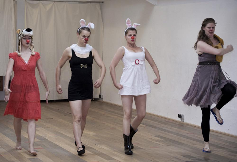 Four female clowns in action during acting and creativity workshop with Ira Seidenstein in Paris, 2010.